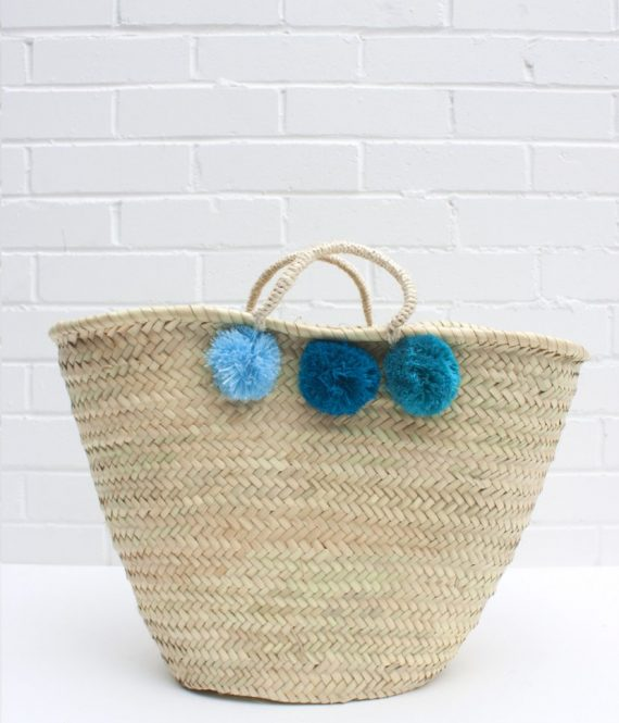 Wicker Basket With Pom Poms : Blue pom wicker basket starburst boutique